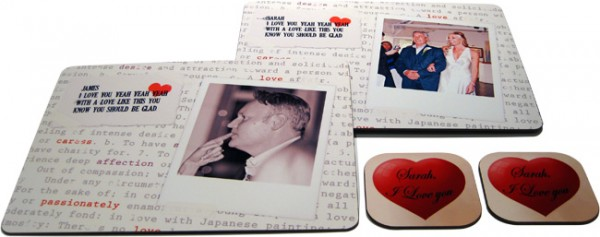Two placemats with photos and text and two coasters with red hearts and text