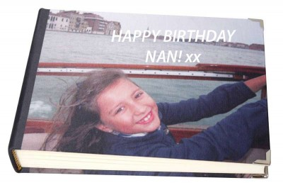Young girl on a boat on the cover of a photo album