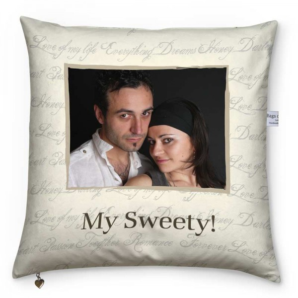 Couple, text and a beige pattern on a cushion