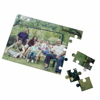 Family sitting in a garden on a jigsaw puzzle