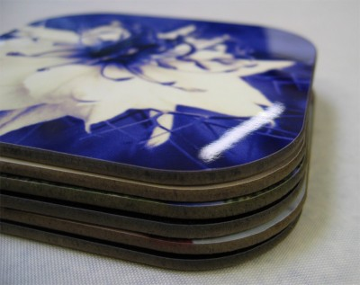 stack of blue photo coasters with white flower