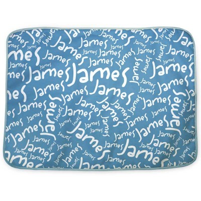 Blue changing mat with James written all over it