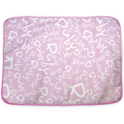 Pink changing mat with the name Ruby written all over it