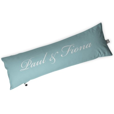 Turquoise sausage shaped cushion with paul and fiona written on it