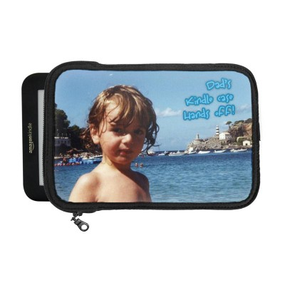 Kindle in case with boy by the ocean and text on it