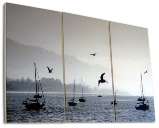 Ocean and boats split three ways on triptych canvas prints