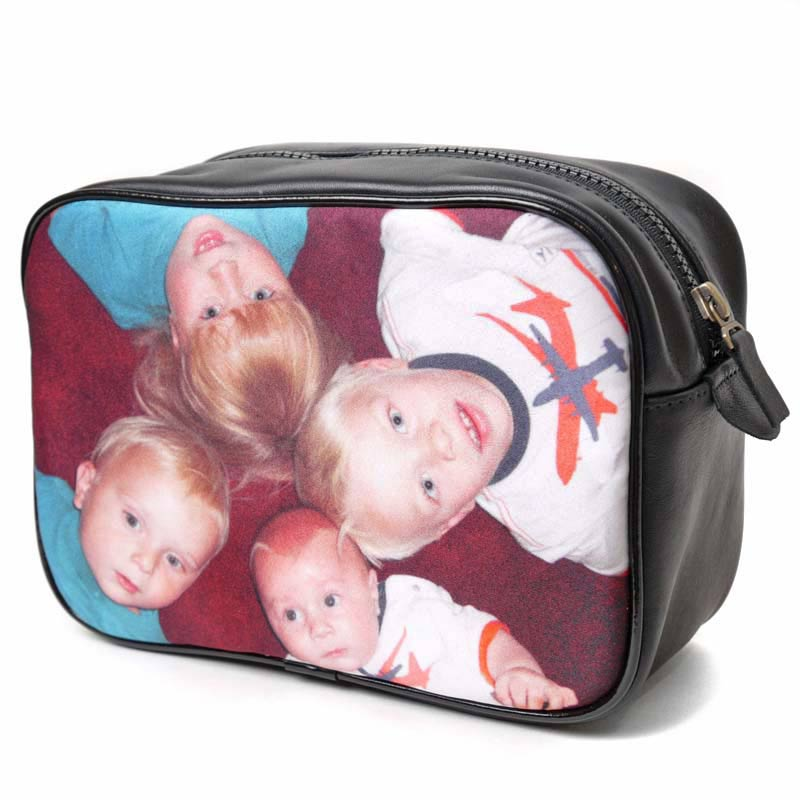 Children on a black leather wash bag