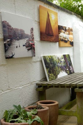 Canvas prints hanging on the wall of a patio