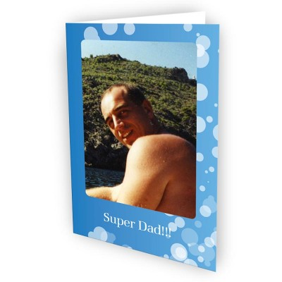 "Man on a blue greeting card with ""super dad"" written on it"