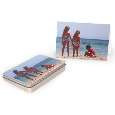 Photo card next to a tin box with the same photo on the cover