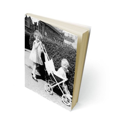 Two children in black and white on the cover of a notebook