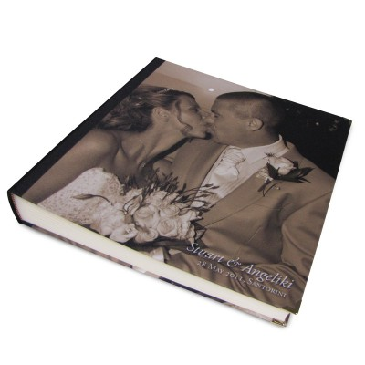 Man and woman on their wedding day on a sepia coloured photo album