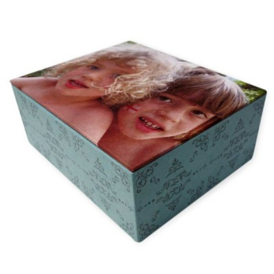 Two kids on the lid of a jewellery box