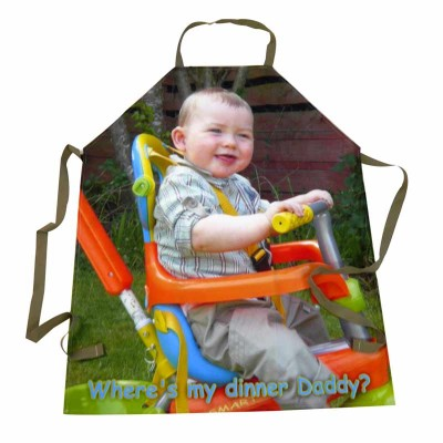 Little boy sitting on a toy on an apron