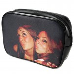 A black make up bag with a photo of two teenagers as unique birthday gift ideas