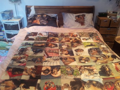 Photo Quilts on a bed with personalised cushions