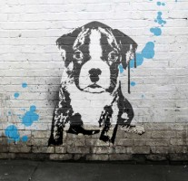 a dog painted on a wall in banksy style