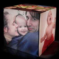 Photo light cube with different photos of a family