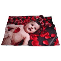 Photo blanket with an image of a baby and red rose petals