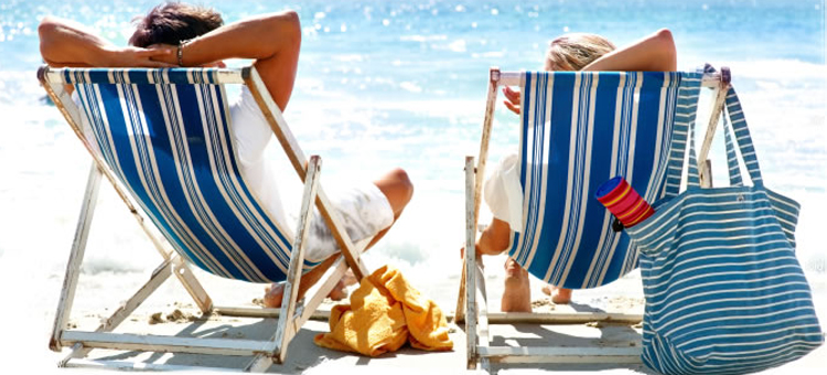 man-and-woman-relaxing-on-deckchairs