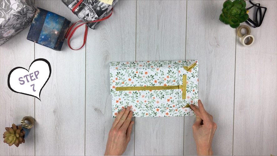 how to make a gift bag from wrapping paper step 7