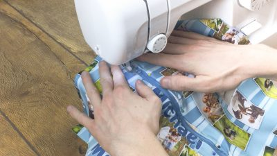 sew a top stitch along the sides of the zip 1cm away